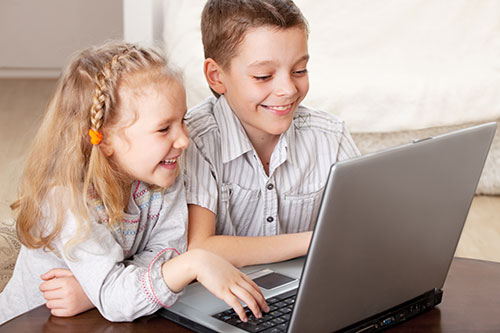 children-with-laptop-indoors