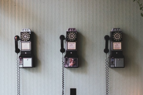 vintage-telephones-hanging-on-floor
