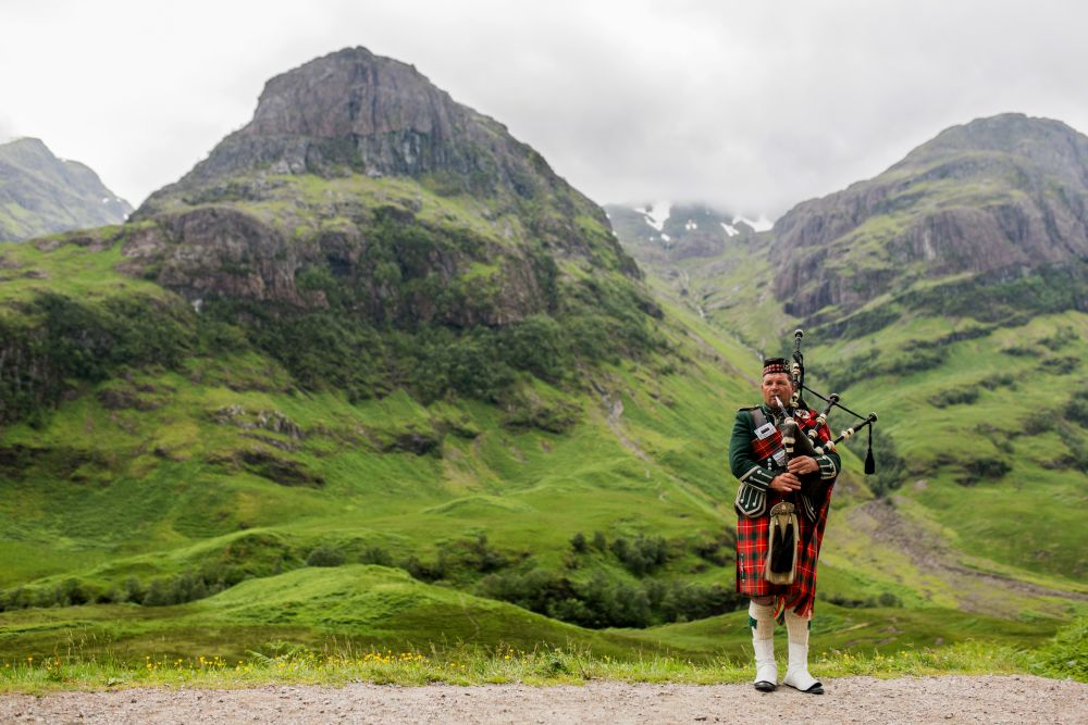 Scottish Bagpiper at Glen Coe Scotland - Diliff